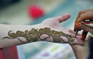 Applying Mehndi on Hands
