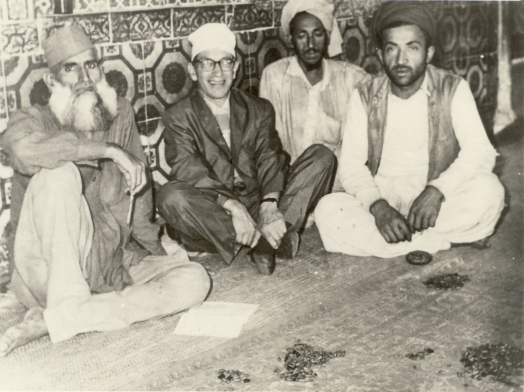 American mystic Samuel Lewis sitting with caretakers of Daata darbaar Shrine Lahore in 1962