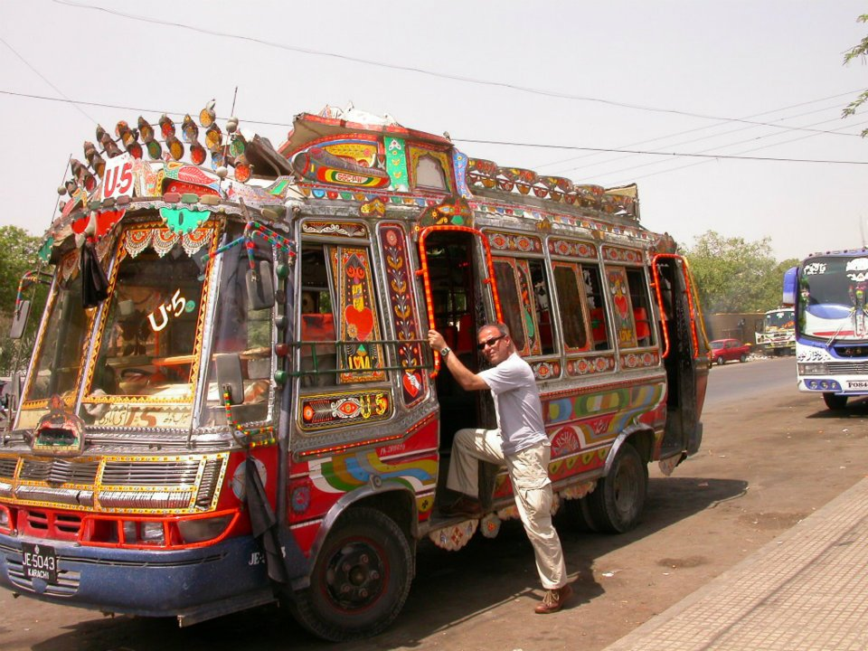 A foreigner travelling by bus in Karachi