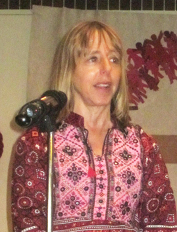 Medea Benjamin addressing wearing Pakistani Dress