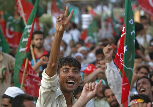 A supporter overwhelms in PTI gathering